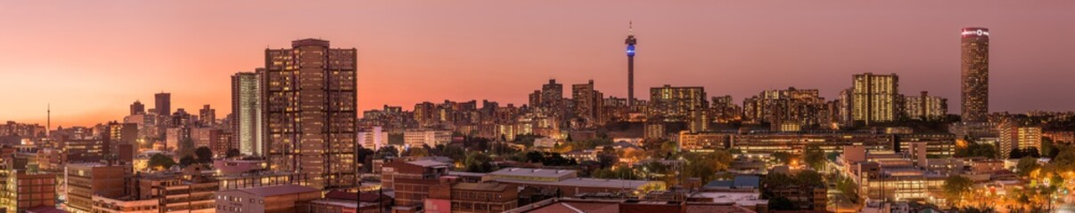 Wall Murals Deep brown A beautiful and dramatic panoramic photograph of the Johannesburg city skyline, taken on a golden evening after sunset.