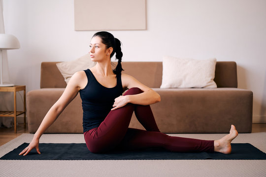 Woman are doing seated twist exercises for health and a firmer body. yoga concept