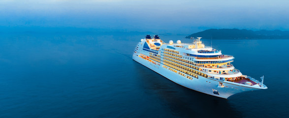 Aerial view of beautiful white cruise ship above luxury cruise in the ocean sea at early in the morning time concept tourism travel on holiday take a vacation time on summer. Fotomurales