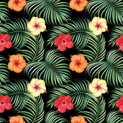 Seamless pattern with tropical branches and hibiscus flowers on black background. Watercolor illustration.