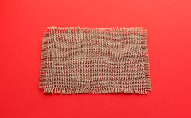 Burlap napkin on red color background