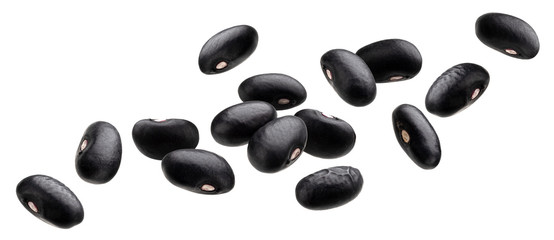 Falling black beans isolated on white background