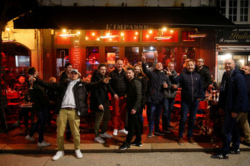 People pose for a picture while enjoying dinner and drinks, after the French Prime Minister announcement that the shut down of no essentials commerces and places will start at midnight in France