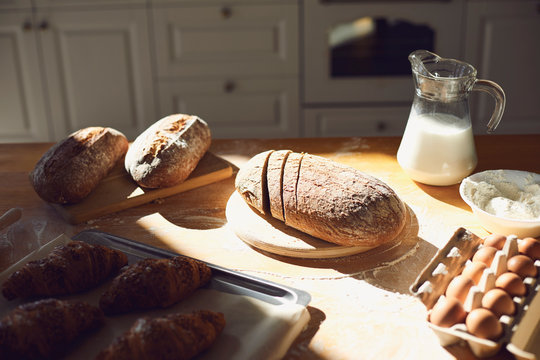 Bakery baker bread. Fresh homemade bread on a table in the kitchen.