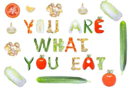 """""""You are what you eat"""" made from vegetables on a white background"""