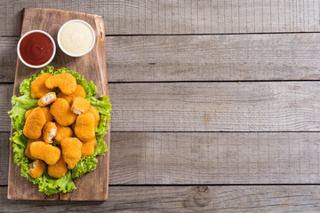 Chicken nuggets in plate on rustic background Wall mural