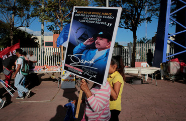 A woman holds a photo of Nicaraguan President Daniel Ortega during a march called 'Walk through Nicaragua in Solidarity, Faith and Hope', held in solidarity with people who are affected by the coronavirus disease (COVID-19), in Managua