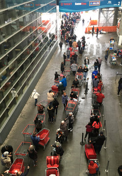 A twisting line of shoppers wait to enter a Costco Wholesale store during the coronavirus outbreak in Yonkers