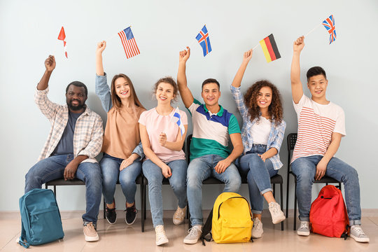 Young students of language school near color wall