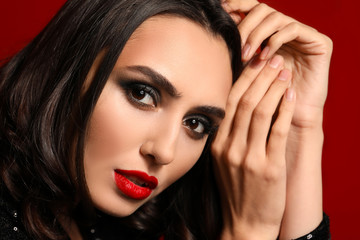 Wall Mural - Young woman with beautiful makeup on color background