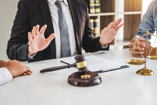 Mediation between marriage, husband and wife during divorce process with male lawyer counselor and signing of divorce contract.