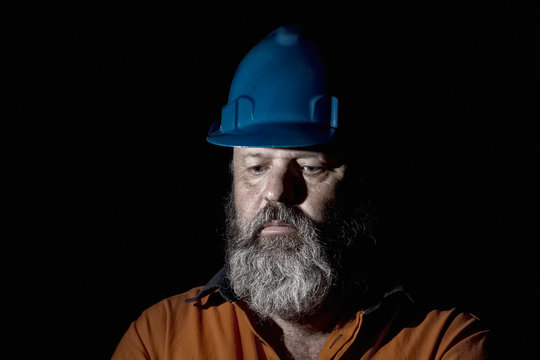 Depression concept for Industry, a fifty year old Worker with a sad expression.