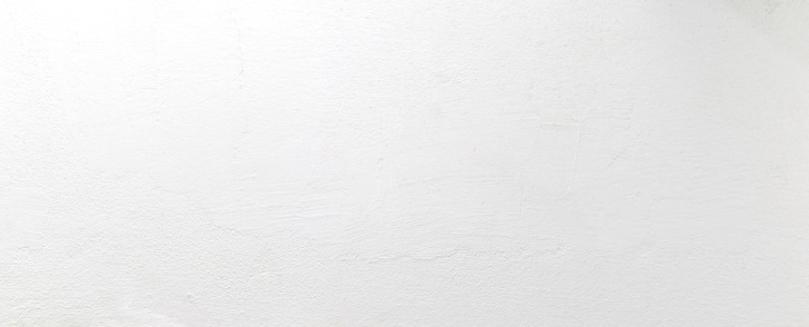 Panorama blank concrete white rough wall for background. Beautiful white wall surface background pattern.
