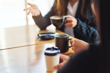 Closeup image of people enjoyed talking and drinking coffee together in cafe