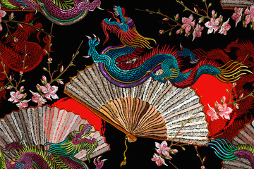 Asian dragons, rising sun, japan fan and sakura flowers. Fashion japanese and chinese style. Template for clothes. Ethnic horizontal seamless pattern. Oriental art