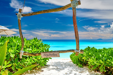 Wall Mural - Beautiful Petite Anse beach with wooden frame at Seychelles