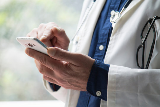 doctor using mobile phone close up view