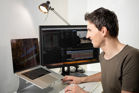 professional video editor on his desk editing an online video