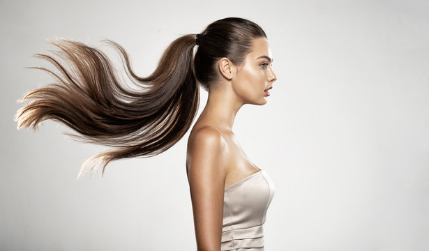 Profile portrait of a beautiful woman with a long straight  hair.