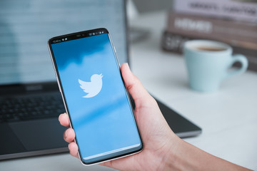 Twitter business CHIANG MAI, THAILAND - Mar 08, 2020 :Women holding Oneplus 6 with Twitter logo on the screen. Twitter is a social media online service for microblogging and networking communication.