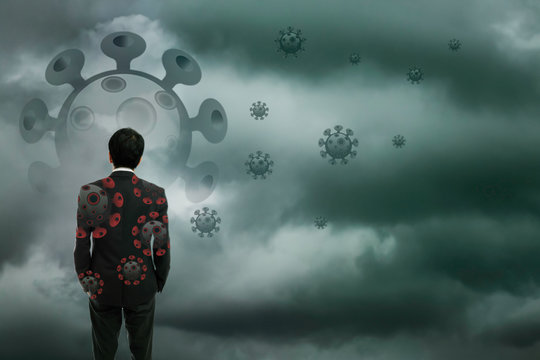 Businessman standing wtih storm cloudy background, Business crisis challenge concept