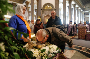 A man kisses the relics of John the Baptist in Kazan cathedral in central Saint Petersburg
