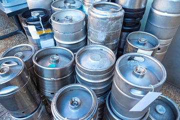Kegs with beer. Metal barrels for beer machines. Kegs for storing and selling draft beer. Metal barrels stand on top of each other. Concept - Sale of low alcohol drinks. Tokyo. Japan.
