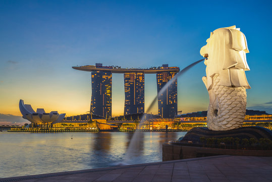 singapore, singapore - February 6, 2020: skyline of singapore with merlion and sands at night