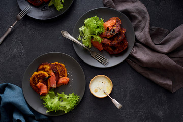 Lunch flatlay with pumpkin fritters with smoked salmon and salad