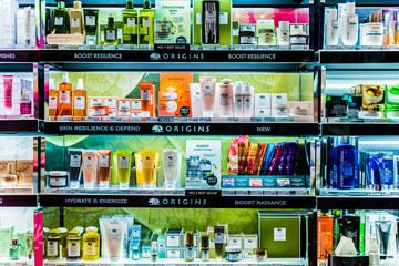 Cosmetics and skincare products on a store shelf in Sephora shop