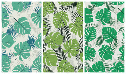 Wall Mural - Trendy tropical seamless pattern with exotic jungle leaves monstera and palm trees, vector set of illustrations