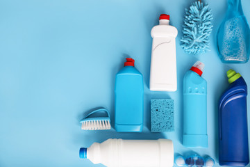 Blue cleaning products on blue background. Top view