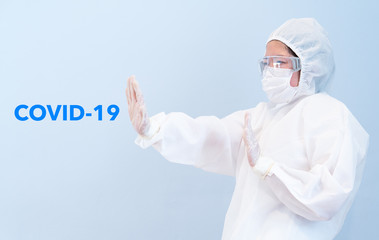 A doctor wearing personal protective equipment including mask, goggle, and suit to protect COVID 19 infection