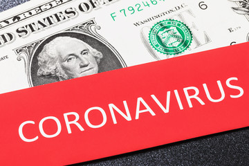 American currency and the sheet with the inscription, closeup. The concept of the effect of coronavirus on the dollar