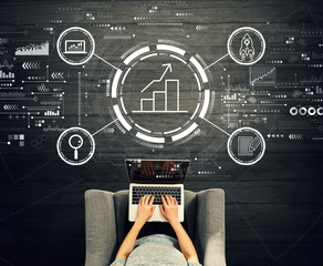Wall Mural - Business growth analysis with person using a laptop in a chair