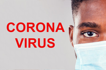 African american male wearing on a gauze mask close up eyes white background studio covid infection epidemia concept