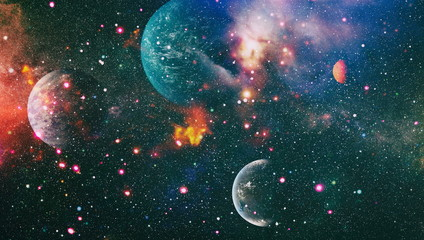Nebula night starry sky in rainbow colors. Multicolor outer space. Star field and nebula in deep space many light years far from planet Earth. Elements of this image furnished by NASA.