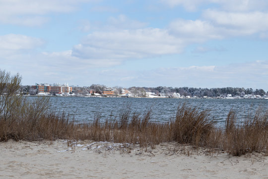 Snow patches along the beach of the riverfront in Yorktown, Virginia, by the inland beach.