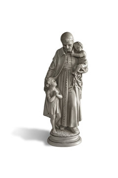 The statue of a saint who is helping children isolated on white background with clipping path