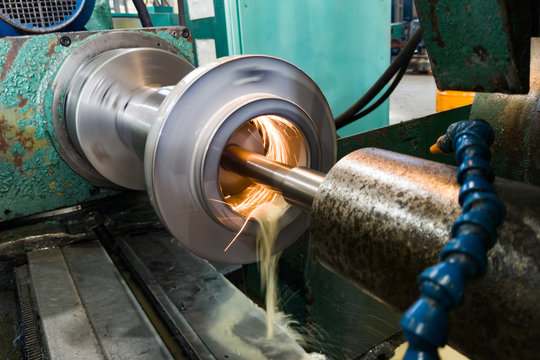 Internal grinding of a cylindrical mandrel with a water-cooled abrasive stone on a grinding machine.