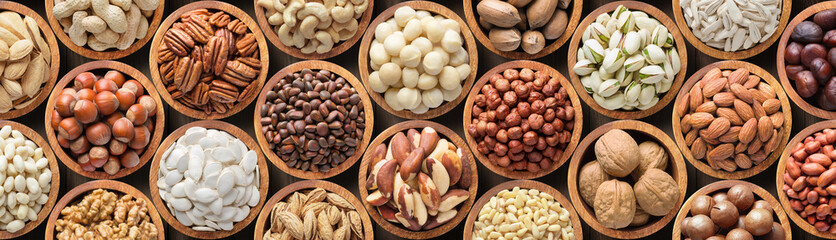 Poster de jardin Nourriture assorted nuts background, vegetarian food in wooden bowls, top view