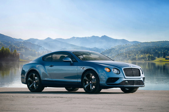 Bentley Continental GT supercar near lake and mountain background