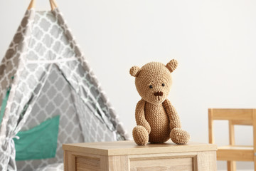 Cuddly toy on table in room Wall mural