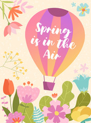 Colorful spring poster or greeting card design - Spring Is In the Air - with a hot air balloon floating over a variety of colorful flowers in meadow, vector illustration