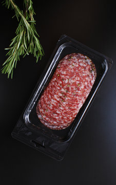 sausage sliced in a package on a black background