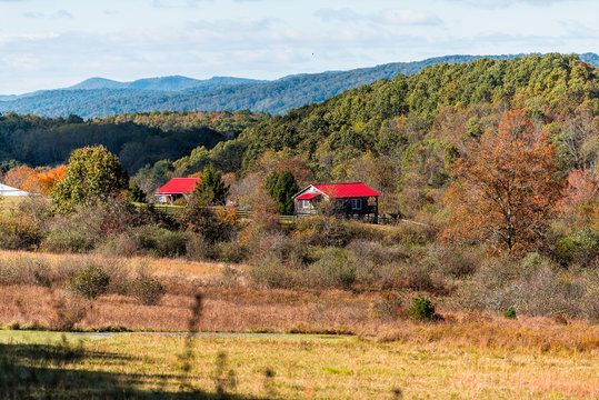 View of red farm houses roof vibrant color in appalachian mountains along highway 220 in Warm Springs, Bath County, Virginia