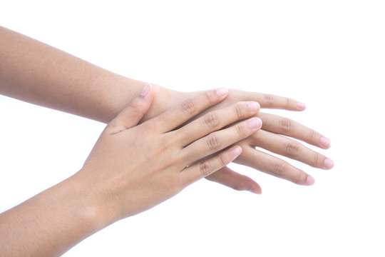 Girl's hand is rub backs of both hands isolated on white