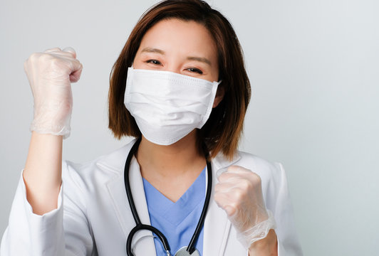 asian doctor wear the medical mask to protect and fight infection from germ, bacteria, covid19, corona , sars , influenza virus on white background.