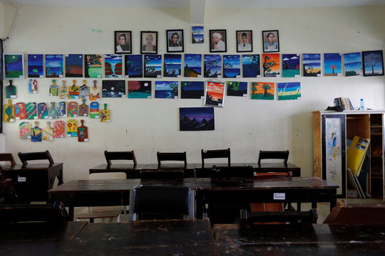 Students artworks and portraits of Indonesian heroes are displayed inside the classroom of a school closed amid the spread of coronavirus in Jakarta