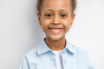 close-up portrait of mulatto, african on half, little girl with curly hair. child with smiling face. isolated over white background Fototapete